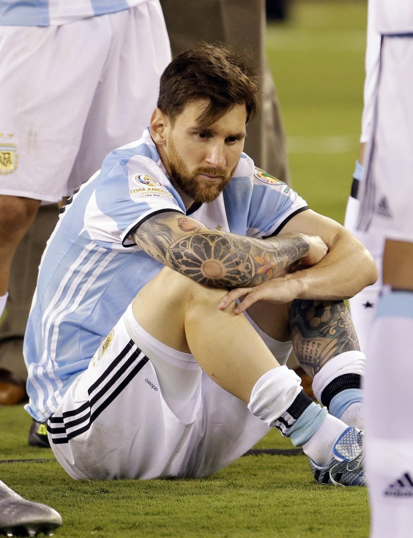 Argentina's Lionel Messi waits for trophy presentations after the Copa America Centenario championship soccer match, Sunday, June 26, 2016, in East Rutherford, N.J. Chile defeated Argentina 4-2 in penalty kicks to win the championship. (AP Photo/Julio Cortez)